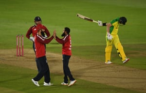 Rashid celebrates after taking the wicket of Smith.