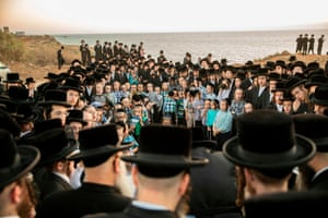 Ultra-Orthodox Jewish men pray next to the Mediterranean while performing the Tashlich ritual, during which 'sins are cast into the water to the fish'.