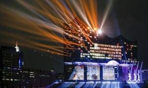 A light show illuminates Elbphilharmonie concert hall in Hamburg on its opening night.