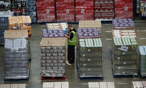 A worker in a supermarket warehouse.