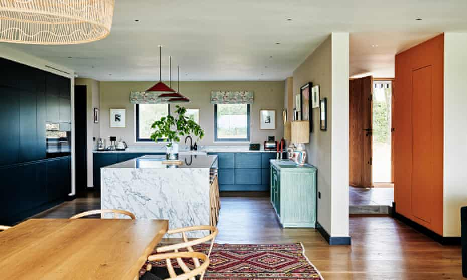 The light-filled kitchen with its teal-coloured units