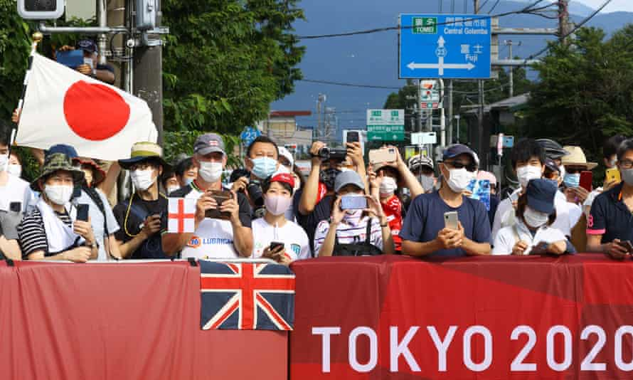 Fans line the route for the men's road race, one of the few events open to spectators at the Tokyo Games.