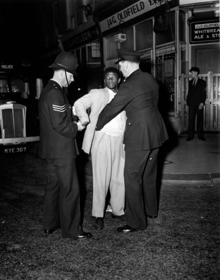 London police search a young man in Talbot Road, Notting Hill, in 1958.