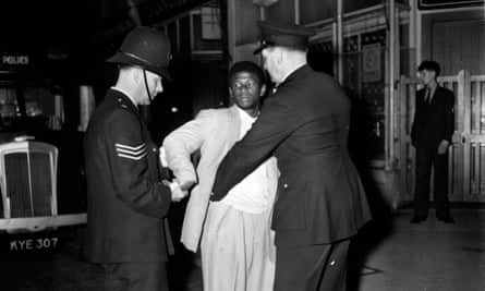 London police search a young man in Talbot Road, Notting Hill during race riots in September 1958.