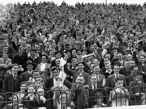 Fans watch Chelsea play Bolton in London.