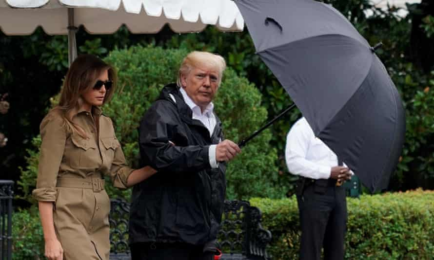 Donald and Melania Trump walk out from the White House before their departure to view storm damage in Texas.