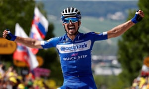 Julian Alaphilippe celebrates after crossing the finish line in Épernay to take the third stage and overall lead.