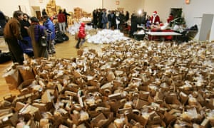 People queue for donated holiday meals and presents in Brooklyn, New York