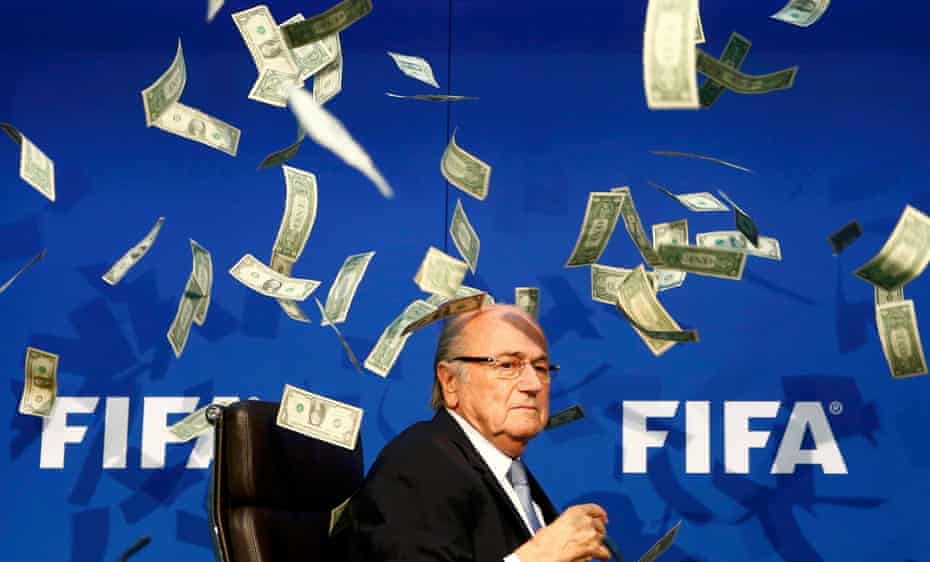 British comedian known as Lee Nelson (unseen) throws banknotes at FIFA President Sepp Blatter