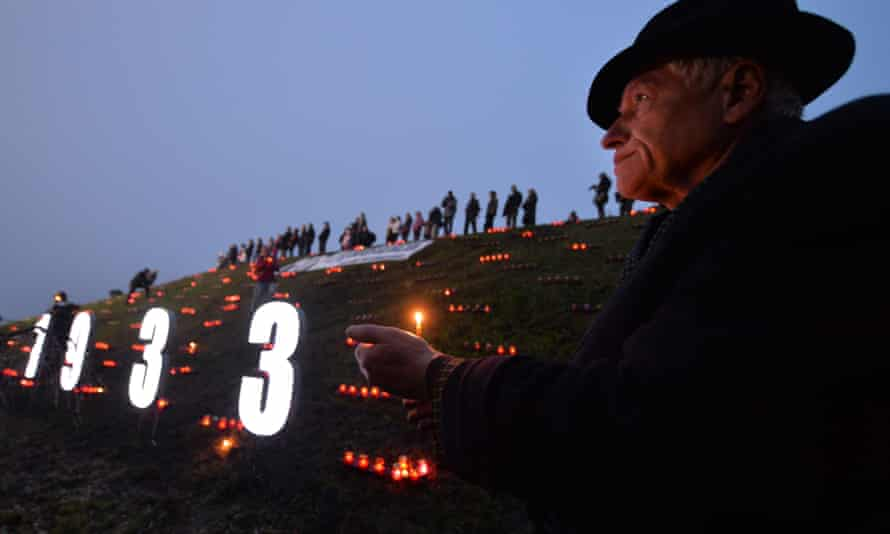 A Ukrainian holds a candle in memory of the victims of the Holodomor famine during a ceremony in Kiev in 2013.