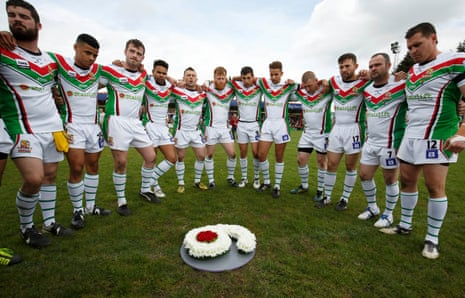 The Keighley players gather round the wreath laid to remember their teammate Danny Jones