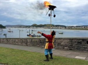 Russel Erwood balances a blazing barbecue on a wooden pole after he was appointed the north Wales town of Conwy's first resident jester in more than 700 years