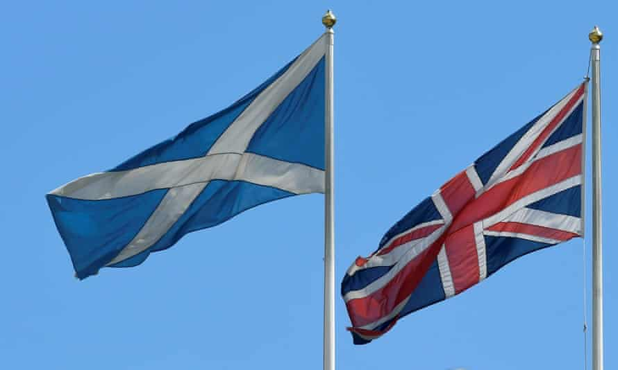 The Scottish Saltire flag flies next to the British Union Jack flag