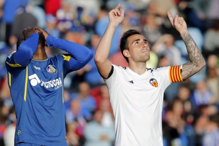 Valencia's Paco Alcacer celebrates after scoring against Getafe.