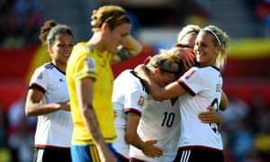 Dzsenifer Marozsan of Germany celebrates with Lena Goessling after their win over Sweden.
