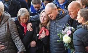Leanne O'Brien, Jack Merritt's girlfriend, is comforted by family members during a vigil at the Guildhall in Cambridge