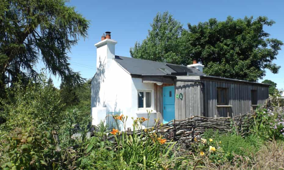 exterior white painted  Birch Cottage