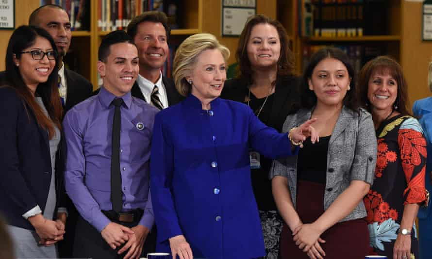 Hillary Clinton, centre, poses with students and faculty after discussing immigration reform at Rancho high school in Las Vegas on Tuesday.