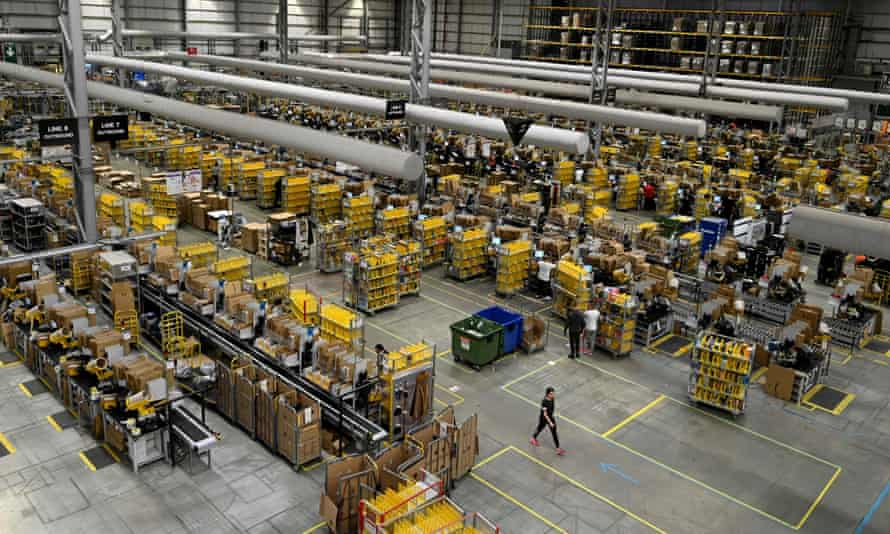Amazon workers sort and pack items at a fulfilment centre in the UK
