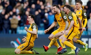 Lewis Dunk celebrates with his teammates after Brighton seal a place in the FA Cup semi-final with a penalty shootout victory against Millwall.