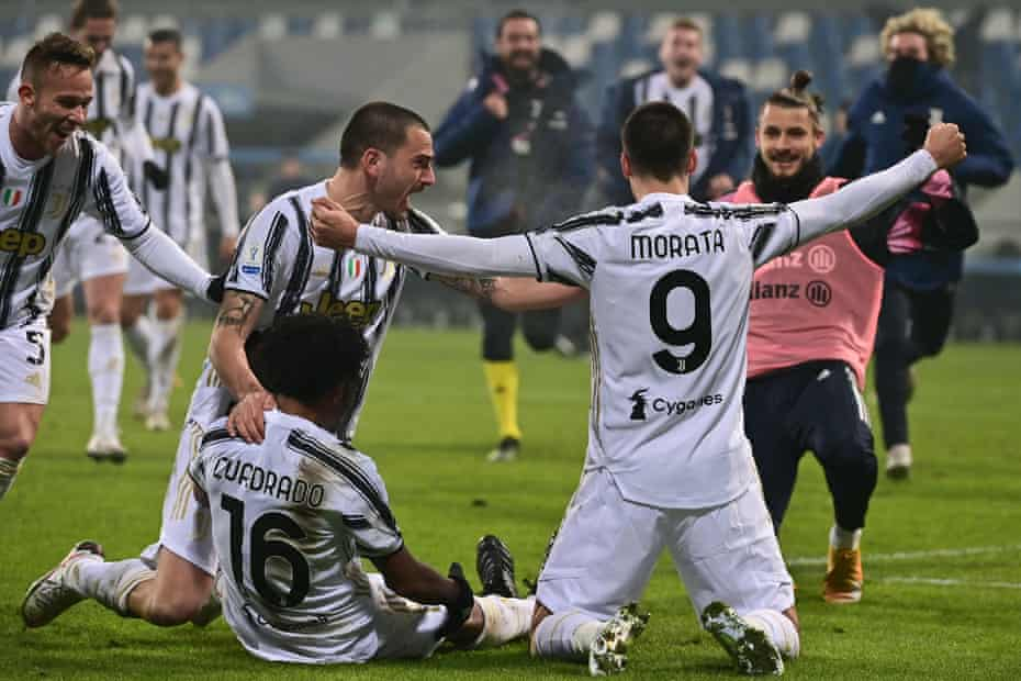 Juventus celebrate after their second goal in added time.