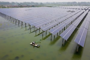 Yangzhou, China: People fish for crayfish next to photovoltaic solar panels at a fishery-solar hybrid photovoltaic power station
