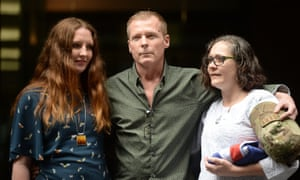 Timothy Weeks poses for a photograph with his sisters Alyssa Carter, left, and Jo Carter in Sydney