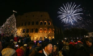 Fireworks light up the sky above the Colosseum, Rome, Italy