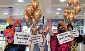 A drag queens welcome New Zealand travellers at Sydney International Airport, Sydney, Monday, April 19, 2021. From Sunday night, travellers from Australia were once again able to cross the Tasman quarantine-free after more than a year of tight restrictions.
