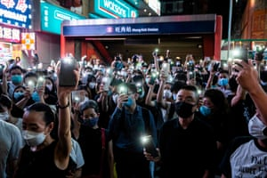 Protesters light up their mobile phones while chanting slogans and singing songs in the Mong Kok district of Hong Kong on June 12, 2020. Thousands of Hong Kongers sang a protest anthem and chanted slogans across the city on June 12 as they marked the one-year anniversary of major clashes between police and pro-democracy demonstrators.