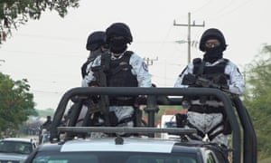 Members of Mexico's national guard patrol a road in San Mateo del Mar, in Oaxaca state, after 15 inhabitants of an indigenous village were bludgeoned to death.