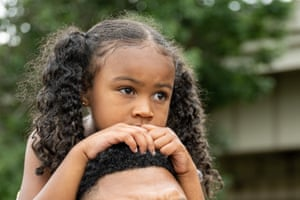 A child watches a performance from her fathers shoulders during the Juneteenth commencement of On the Banks of Freedom in Louisville, Kentucky. On the Banks of Freedom is a public art project highlighting Louisvilles unnamed slave population