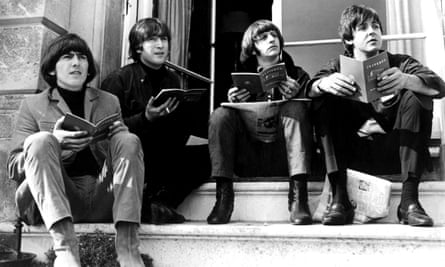 the Beatles catch up with some reading during a break in the filming of Help! in 1965.