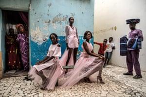 Models Diarra Ndiaye, Ndeye Fatou Mbaye and Malezi Sakho wear outfits by the Senegalese designer Adama Paris in Dakar, Senegal.