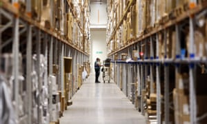 Warehouse employee picks items from racking
