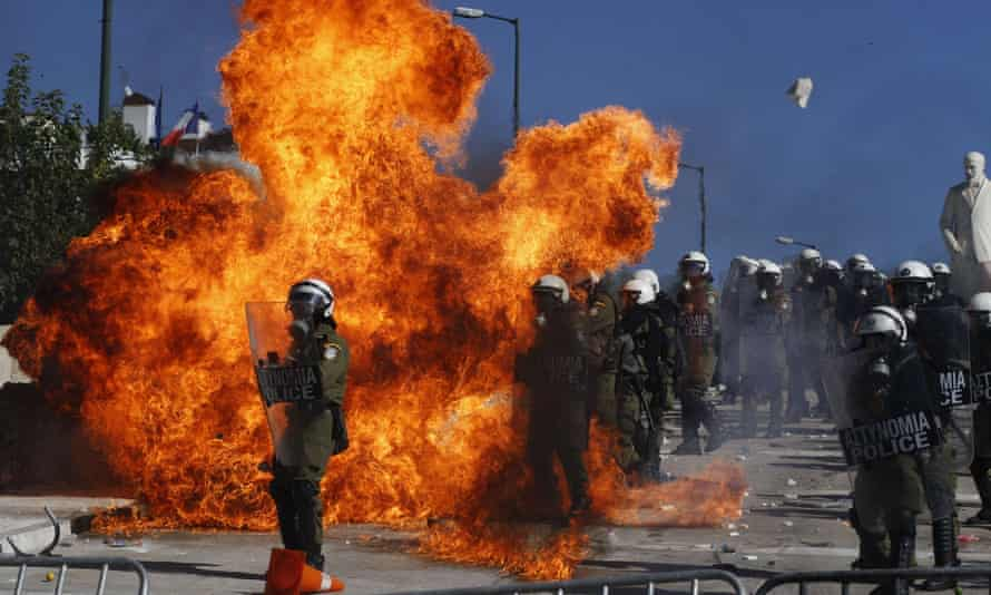 Riot police clash with demonstrators outside parliament in Athens, October 2011, as anger breaks out over new austerity measures