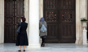 Two women standing outside the Cathedral of Athens, at a relative distance from each other in Athens, Greece, 12 April 2020. EPA/Alexander Beltes
