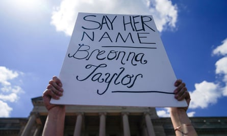 A person holds a sign in Frankfort, Kentucky, on 25 June.