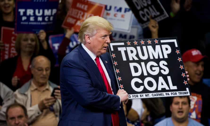 Republican presidential nominee Donald Trump holds a sign supporting coal during a rally at Mohegan Sun Arena in Wilkes-Barre, Pennsylvania.