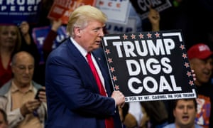 Donald Trump holds a sign saying 'Trump Digs Coal' in Wilkes-Barre, Pennsylvania