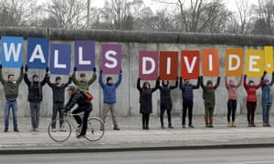 Protesters gather at the Berlin Wall Memorial in Berlin. The city's mayor has warned Donald Trump against building a border wall.