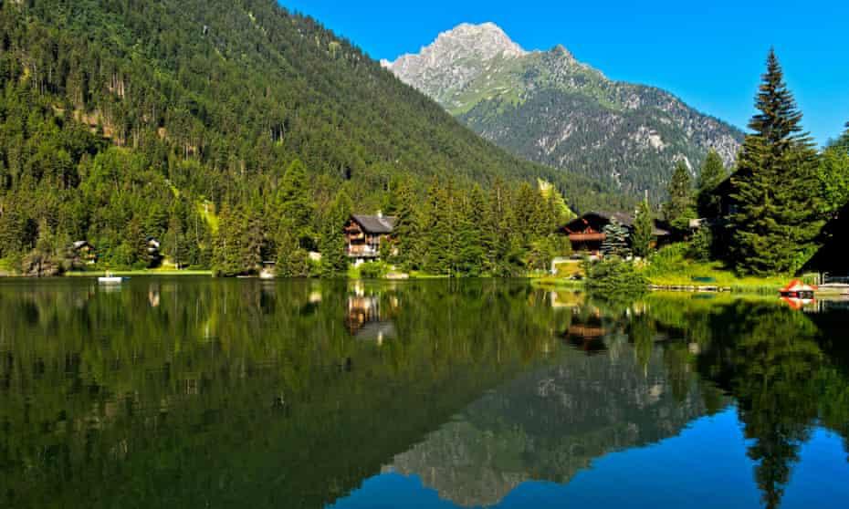 Mountain lake Lac de Champex with mirroring,