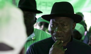 Nigeria's president, Goodluck Jonathan, waits to be accredited as a voter in his home village of Otuoke