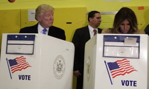 New YorkRepublican presidential candidate Donald Trump looks at his wife Melania as they cast their votes at PS-59