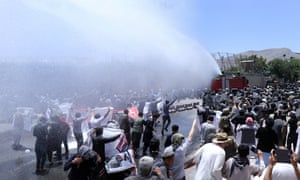 Afghan security officials use water cannon against protesters
