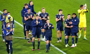 Scotland players applaud the fans after the final whistle.