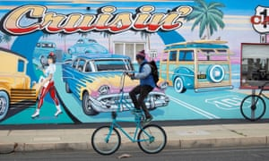 A man rides a modified bike past a diner after California lifted its regional stay-at-home orders across the state during the outbreak of coronavirus.