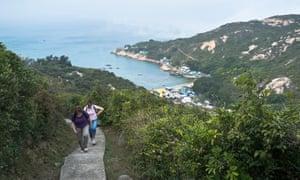 Hikers walking path Po Toi island Hong Kong walk.