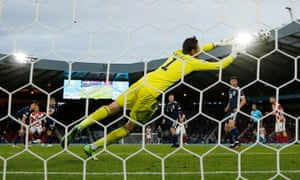 Croatia's Luka Modric scores their second goal as Scotland's David Marshall attempts to make a save.