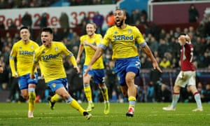 Leeds' Kemar Roofe celebrates scoring their third goalto win the match.